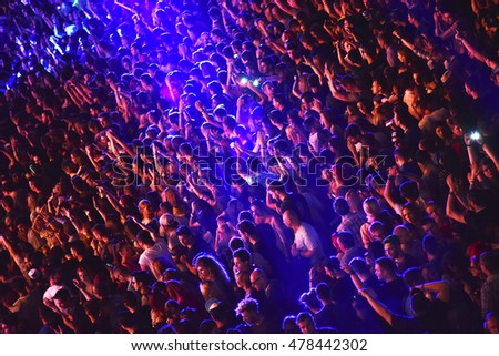 CLUJ NAPOCA, ROMANIA - JULY 8, 2016: Crowd having fun with raising hands at a Lost Frequencies live concert at Untold Festival, the Best Major Music Festival of Europe #478442302