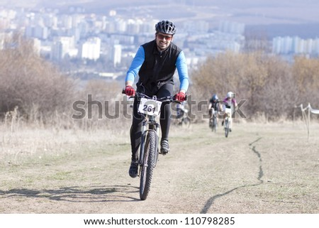 """CLUJ-NAPOCA, ROMANIA - MARCH 24: Unidentified competitors during the Clujul Pedaleaza mountain bike competition, 1st stage """"Napolact"""" ; on March 24, 2012 in Cluj-Napoca, Romania."""