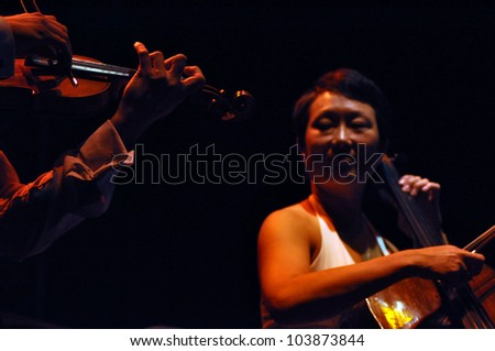 CLUJ NAPOCA, ROMANIA � MAY 29: Vocalist Storm Large from Pink Martini pop-jazz band performs live at the Sports Hall of Cluj, Romania, MAY 29, 2012 in Cluj-Napoca, Romania - stock photo
