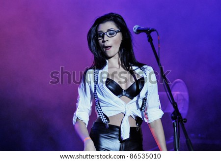 CLUJ NAPOCA, ROMANIA – OCTOBER 8: Bebelusa Cristina from Prima TV show, performs sexy dancing live during a Voltaj concert at Cluj Arena Grand Opening show, on October 8, 2011 in Cluj-Napoca, Romania