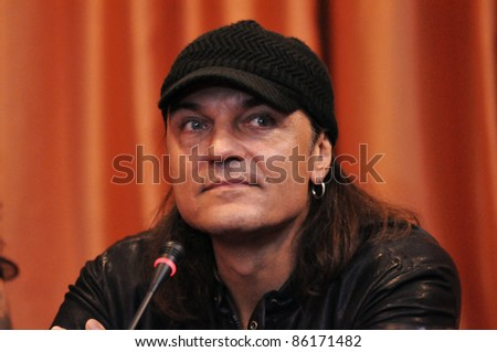 CLUJ NAPOCA, ROMANIA – OCTOBER 07: Matthias Jabs from Scorpions rock band attends Cluj Arena Grand Opening concert press conference, at Hotel City Plaza on October 07, 2011 in Cluj, Romania