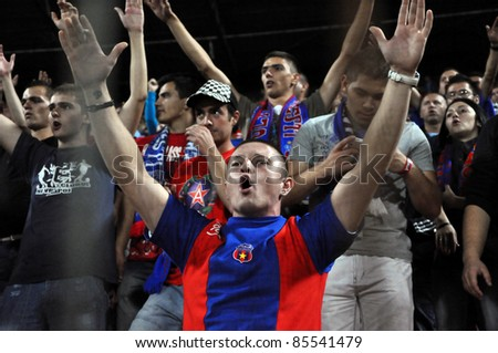 CLUJ NAPOCA, ROMANIA - SEPTEMBER 15: FC Steaua Bucharest team fans show support during a game in Europa League against Schalke 04 on September 15, 2011 in Cluj Napoca, Romania
