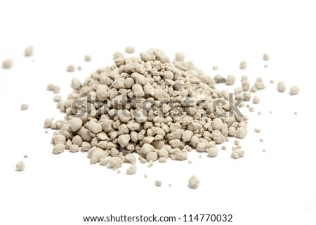 clumping clay cat litter isolated on white