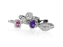 Cluster grouping stack of diamond wedding engagement rings with colored diamonds and gemstones