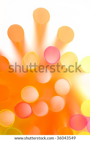 Cluster of colorful straws in close up view. Soft focus. Abstract background.