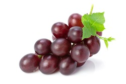 Cluster of ripe red grape fruit with green leaf isolated on white background. Full depth of field. Clipping path.