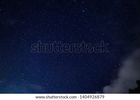 Clusters of millions of stars and galaxies and planets as seen from our earth in the night sky. The brightest one in this photo is Jupiter(top, centre). #1404926879