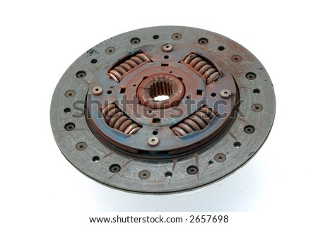 clutch plate just removed from a car showing wear out and dust springs - stock photo