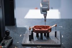 CMM Coordinate Measuring Dimension Machine inspecting workpiece. Industrial manufacturing