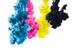 cmyk color paint in cyan, magenta, yellow and black