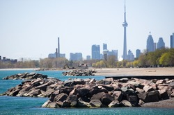 CN tower , the beaches - famous place of toronto , sea and sky background