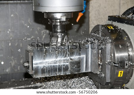 CNC drilling and milling in a workshop that manufactures disks and blades for cutting paper.