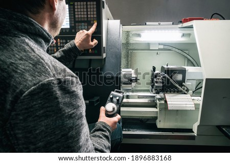 Cnc machine. The CNC lathe machine or Turning machine. Turning numerical control machine with tools and chuck fot automotive