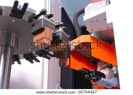 stock photo CNC machine with a mechanical arm and rotate tool changer