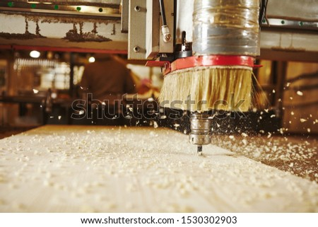 CNC milling machine. Machine tool in wood factory with drilling machines.