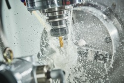 CNC milling machine work. metal processing with coolant