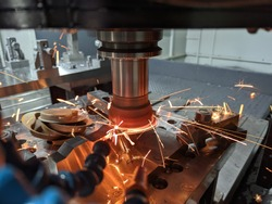 cnc milling of hardened steel with sparks - closeup with selective focus and blur