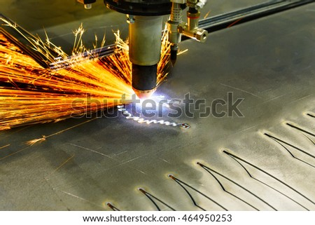 CNC plasma cutting machine during operation. Processing of the steel sheet. #464950253