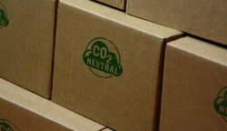 CO2 carbon neutral emission stamp printed on cardboard box. Ecology, nature friendly, climate change, green fuel and earth protect concept.