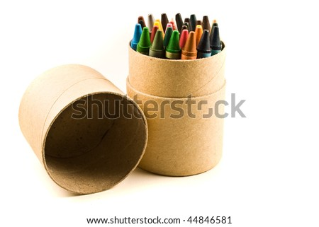 Co-lours pencil placed on a board box isolated on a white background