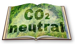 CO2 Neutral text - 3D rendering opened photobook concept against a forest backgound