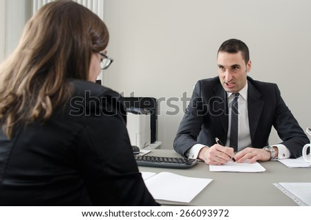 Co-workers discussing business plan in office  - Shutterstock ID 266093972