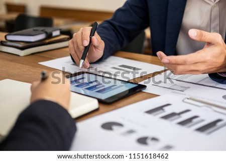 Co working conference, Business team meeting present, investor colleagues discussing new plan financial graph data on office table with laptop and calculator, Finance, accounting, investment.