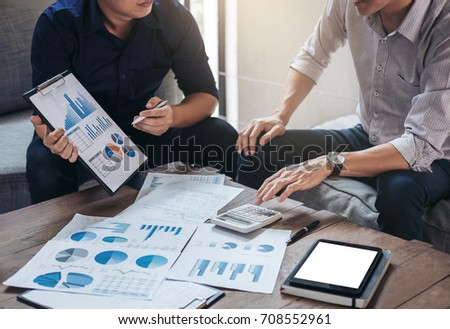 Co working conference, Business team meeting present, investor colleagues discussing new plan financial graph data on office table with laptop and digital tablet, Finance, accounting, investment. #708552961