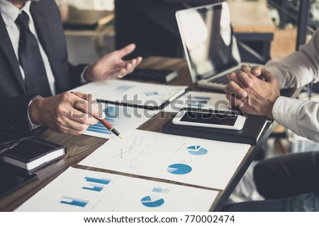 Co working conference, Business team meeting present, investor colleagues discussing new plan financial graph data on office table with laptop and digital tablet, Finance, accounting, investment. Stockfoto ©
