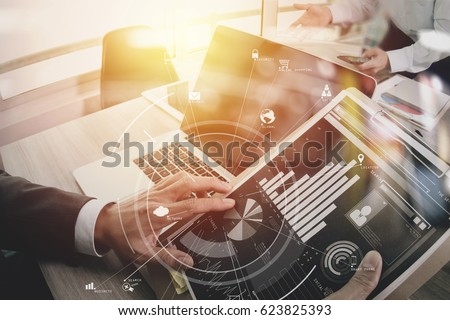 co working team meeting concept,businessman using mobile phone and digital tablet and laptop computer in modern office with virtual icon diagram #623825393
