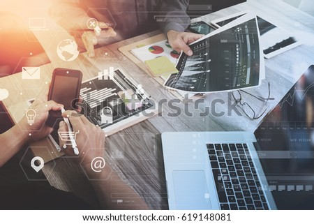 co working team meeting concept,businessman using mobile phone and laptop and digital tablet computer in modern office with virtual interface icons network diagram #619148081