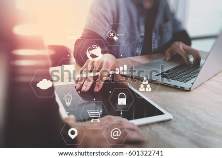 co working team meeting concept,businessman using smart phone and laptop and digital tablet computer in modern office with virtual interface icons network diagram #601322741