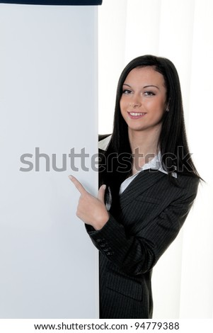coach before empty flipchart on education and training - stock photo