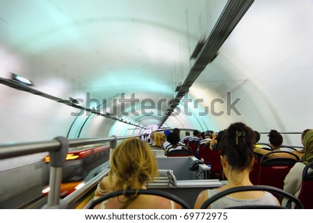 Coach bus rides in tunnel, many tourists visiting Rome, Italy