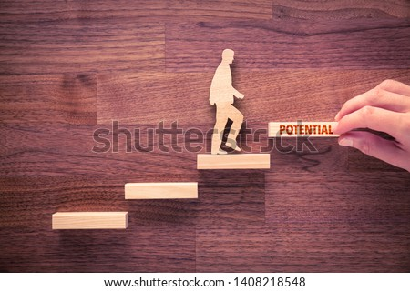 Coach motivate to potential improvement. Hand with the last peace of stair and person made from wood and wooden stairs, the last with text potential.