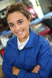 Coachbuilding tRaining girl standing in garage