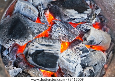 coal and wood ash burning in an oven