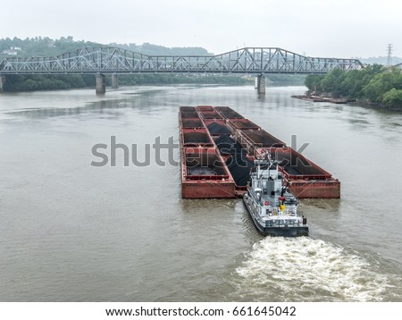 Coal barge and pusher boat on Ohio River