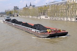 Coal barge and tugboat on the Seine River, Paris, Île-de-France, France