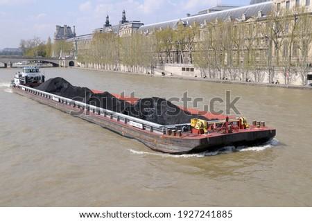 Coal barge and tugboat on the Seine River, Paris, Île-de-France, France Stock photo ©
