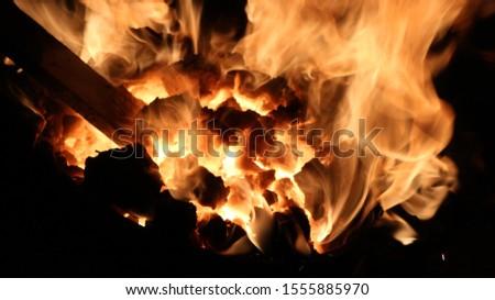 coal burning forge burning metal #1555885970