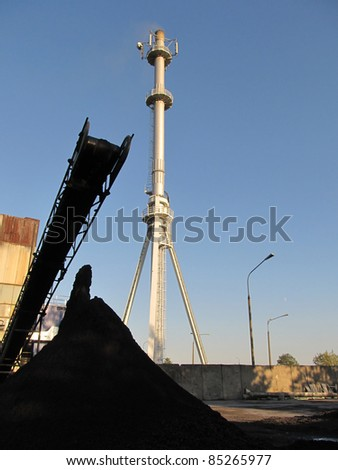 coal combustion waste: slag and gases coming out the chimney