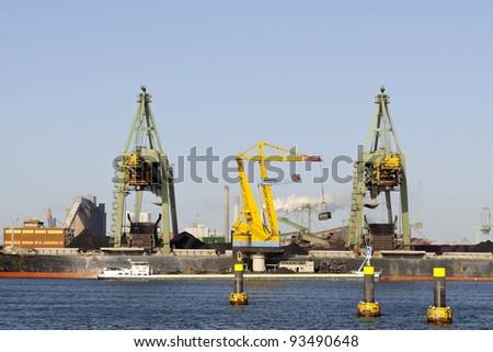 coal cranes in the harbor of rotterdam
