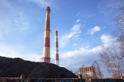 Coal heap, natural black coal with industrial chimney. Industrial landscape. Global warming, CO2 emission, coal energy issues. Coal mine in Katowice, Poland.