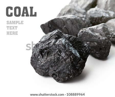 Coal lumps spilled on white background with copy space