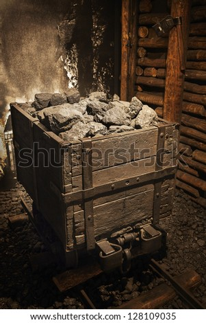 coal mine cart full of coal
