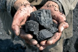 coal miner in the hands of