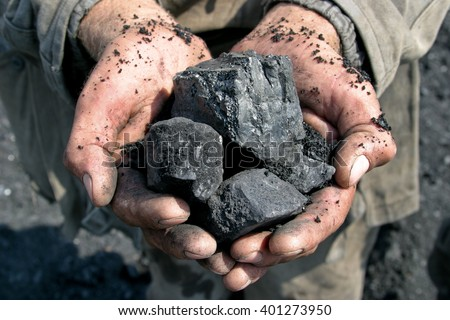 coal miner in the hands of Imagine de stoc ©