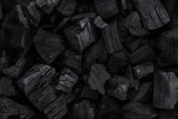 Coal mineral black as a cube stone background. Coal pattern