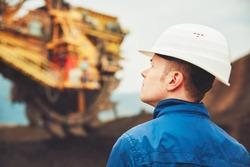 Coal mining in an open pit - Worker is looking on the huge excavator - industry in Czech Republic